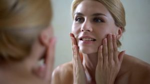 a woman thinks she will benefit from aesthetic services